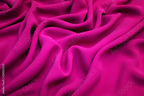 Fototapeta  The texture of silk fabric in fuchsia. Background, pattern.