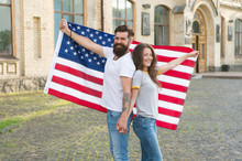 National Holiday. Bearded Hipster And Girl Celebrating. 4th Of July. American Patriotic People. American Citizens Couple USA Flag Outdoors. Patriotic Spirit. Independence Day. American Tradition