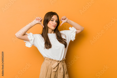 Young caucasian woman feels proud and self confident, example to follow Fototapet