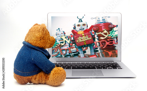 old teddy bear looking at his friends celebrating Christams