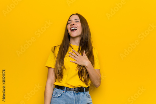 Fotografie, Obraz  Young ginger redhead woman laughs out loudly keeping hand on chest