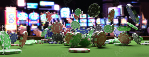 Fotografia Poker chips falling on green felt roulette table, blur casino interior background