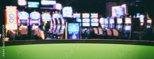 Fotografering Casino slot machines, green felt roulette table closeup view