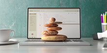Zen Stones Stack On A Computer Laptop Office Desk Background. 3d Illustration