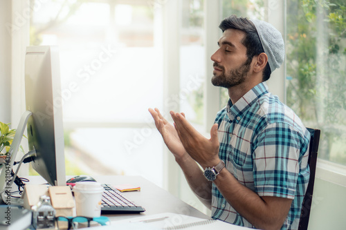 muslim businessman praying and having dua to Allah asking for his business succe Fototapeta