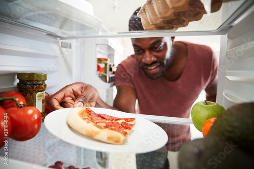 Fotografía View Looking Out From Inside Of Refrigerator As Man Opens Door For Leftover Take