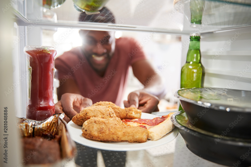 Fototapety, obrazy: View Looking Out From Inside Of Refrigerator Filled With Unhealthy Takeaway Food As Man Opens Door