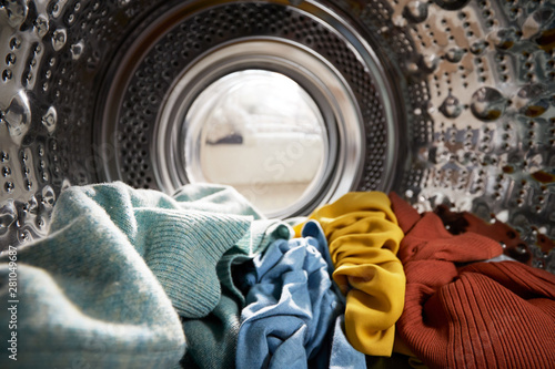 Photo View Looking Out From Inside Washing Machine Filled With Laundry
