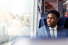 Businessman Sitting In Train C...