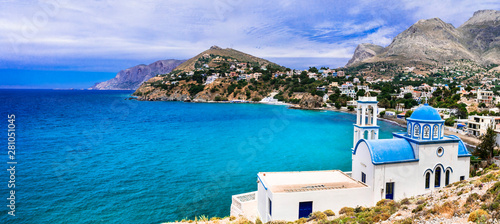 Scenery of Kalymnos island - picturesque church overloong the sea. Panormos