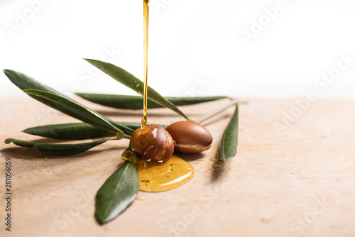 argan oil pouring over argan seeds Canvas Print