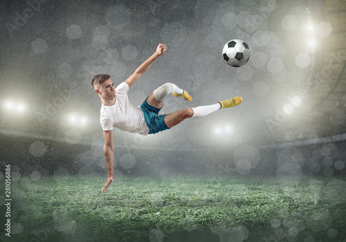 Fotografie, Obraz  Soccer player on a football field in dynamic action at summer da
