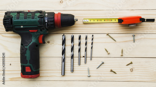 Carpenter workplace with drill and ruler