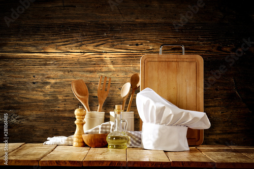 Poster de jardin Montagne White cook hat with kitchen tools on wooden background