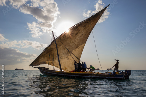 Leinwand Poster traditional dhow sailing boat setting sail for the open ocean and destination ha