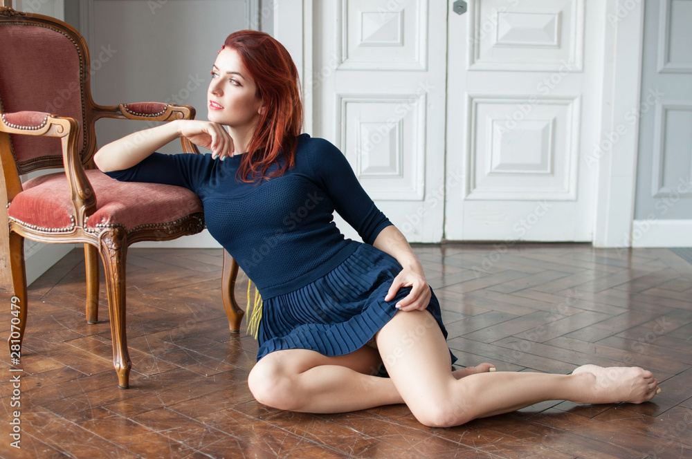 Fototapety, obrazy: beautiful girl in blue dress in a graceful pose on a wooden vintage floor