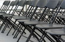 Numerous Folding Chairs Arranged In A Row