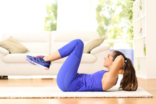 Sportswoman Exercising Abs Doing Crunches At Home