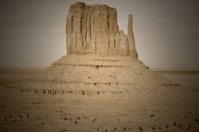 Monument Valley Is A Region Of The Colorado Plateau Characterized By A Cluster Of Vast Sandstone Buttes Above The Valley Floor. It Is Located On The Arizona-Utah State Line, USA