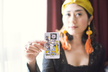 """Closeup To A Tarot Card Of """"Death"""" Blur Focus Of Gypsy Woman"""