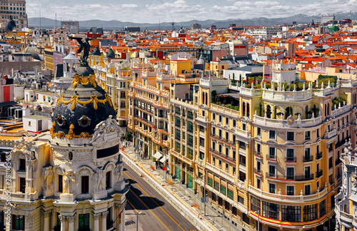 Cadres-photo bureau Madrid Madrid, Spain. Famous streets Gran Via and Calle de Alcala crossroads in Downtown. Top view to the classic Spanish buildings architecture.