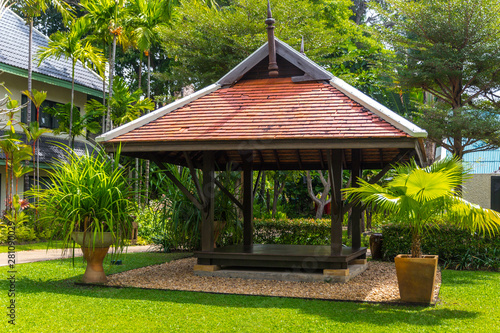 beautiful wooden gazebo and nice green lawn Fototapeta