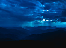 The Mountain Landscape On The Cloudscape Background. Evening Night Time