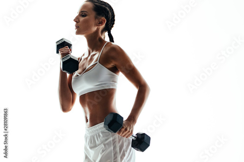 Fit woman exercising with dumbbell weights Fototapeta