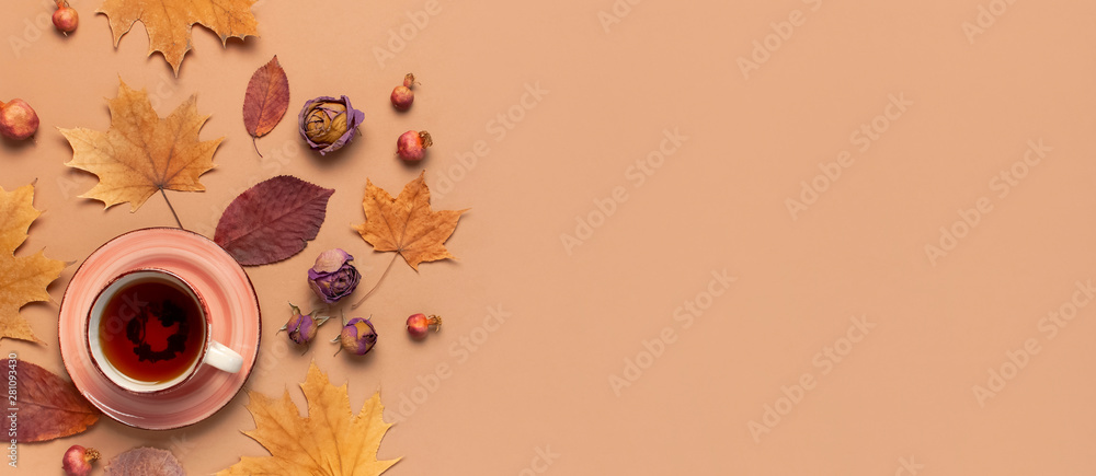 Fototapety, obrazy: Autumn Flat lay composition. Cup of tea, autumn dry bright leaves, roses flowers, orange circle, cones, decorative pomegranate, cinnamon sticks on brown beige background top view. Autumn, fall concept