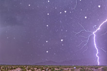 A Lightning Bolt Striking Only 1000 Feet Away In Arizona. The White Dots In The Image Are Rain Drops Frozen In Midair By The Strobe Light Effect Of The Lightning Bolt..