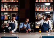 Bartenders Working In Bar