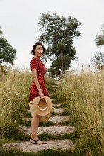 Asian Woman On Natural Path