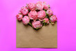 canvas print picture - Envelope of craft paper with pink roses. Congratulation with wedding, birthday, valentines day.