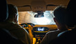 Italy, Sicily, two men in car in a tunnel