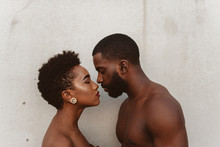 Close Up Of Young Couple Standing By Wall
