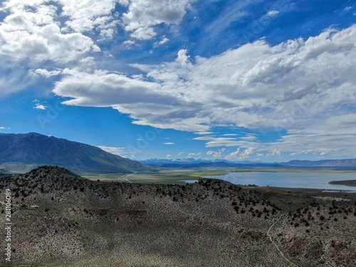 Aerial view of Lake Crowley over the mountain during blue summer day Wallpaper Mural