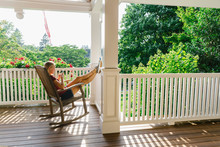 Teen Girl On Rocking Chair Texting