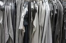Twenty Shades Of Grey And Black Clothing Hanging On A Rack
