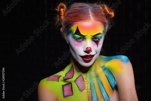 Fotografia Playful lady with a face painting clown.