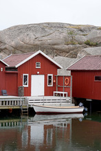 Decorative Cabins In Harbor On The Coast Of Sweden