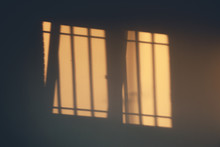 Sunlight And Shadows Of Windows On The Wall Background In Evening
