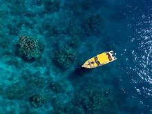 Yellow Boat In The Ocean