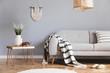 Leinwandbild Motiv Design bohemian composition of living room interior with gray sofa, wooden coffee table, beige macrame, rattan lamp ,plants, plaid and elegant accessories. Stylish home decor. Template.