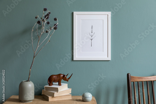 Obraz Design interior of living room at modern apartment with white mock up photo frame, wooden shelf, stylish chair, vase with flower, books, sculpture and elegant accessories. Stylish home decor, Template - fototapety do salonu
