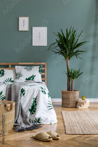 Boho style bedroom with basket and exotic plant Wall mural