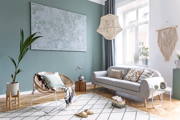 Boho style living room with macrame, rattan armchair and sofa