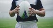 Male rugby player holding rugby ball in the stadium 4k