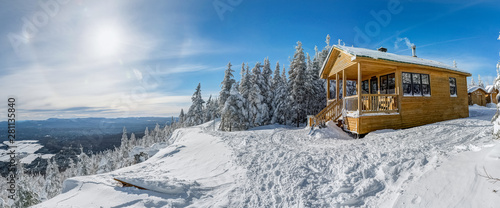 Panoramic view of the wooden cabin at the edge, perfect winter day for a hike, Megantic national park, Quebec, Canada