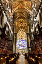 Vaulted Ceiling At The Front Choir Organ Pipes With Spinning Globe Inside The Medieval Salisbury Cathedral Salisbury England