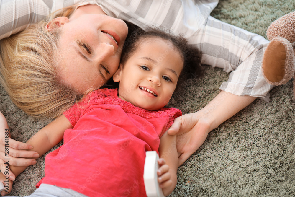 Fototapety, obrazy: Happy woman with her little African-American daughter at home